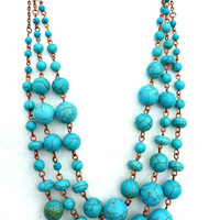 Copper three strand turquoise howlite stone necklace.