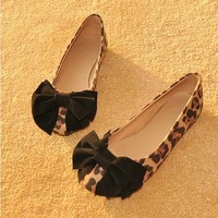 Low to help leopard bow round flat heels  BACEC