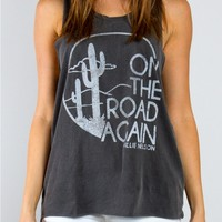 This super soft and lightweight sleeveless Willie Nelson - On The Road Again lyric print inside of tee features a round neckline, classic fit cut and multiple dyed processed, sleeveless with low armhole, Saguaro Cactus print with On The Road Again written