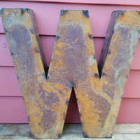 "Rusted Metal Letter ""W"" Crafted From Recycled Tin"