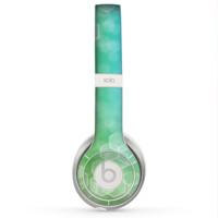 The Abstract Shaped Sparkle Unfocused Blue & Green Skin for the Beats by Dre Solo 2 Headphones