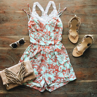 A Strappy Floral Romper in Aqua and Red