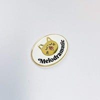 Melodramatic enamel pin