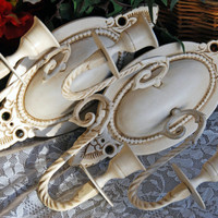 Shabby chic wall decor: Set of 2 ornate vintage white hand-painted decorative oval taper candle holder sconces