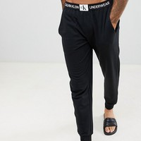 Calvin Klein Monogram Joggers with Cuffed Ankle at asos.com