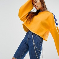 The Ragged Priest Cropped Sweat With Wide Sleeves And Checkerboard at asos.com