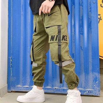 NIKE New fashion embroidery letter hook couple pants Army green
