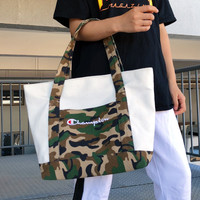 Champion men and women Hand bag