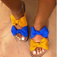 Bow tie flat bottom sandals