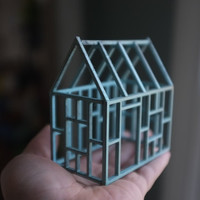 Miniature architectural framework house in pale blue stained birch