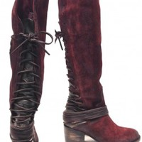 This a striking hand-distressed knee high boots features a vintage inspired washed suede throughout, a round toe, contrast with tonal suede backs & leather lacing that wraps multiple times around the ankle and laces up to topline, partially side zip closur