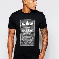 adidas Originals | adidas Originals T-Shirt With Snow Camo Print AB9591 at ASOS
