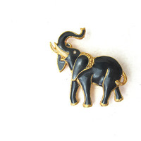 Vintage black and gold elephant pin / brooch trunk up