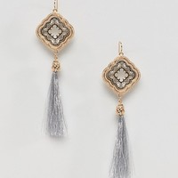 ASOS DESIGN Occasion Filigree Metallic Tassel Earrings at asos.com