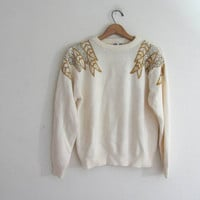 80s white sweater. sweater with gold feather sequins. size M