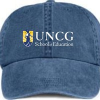 Pigment-Dyed Cap embroidered with UNCG school of Education logo.