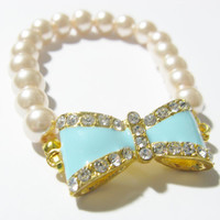 Cream Pearl bracelet with blue crystal bow