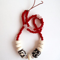 Long bold necklace with matte red glass beads, glass and horn African beads on copper colored leather cord Fall fashion An Astrid Endeavor