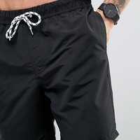 ASOS Swim Shorts In Black Mid Length at asos.com