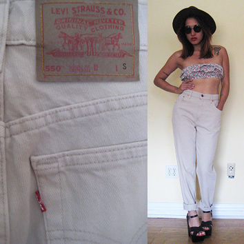 Vintage size 28 Levi's 550 high waisted tapered legs nude beige cream creme 80's
