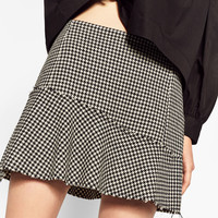 MINI SKIRT WITH FLOUNCE DETAILS