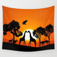 Giraffe silhouettes at sunset Wall Tapestry by Laureenr