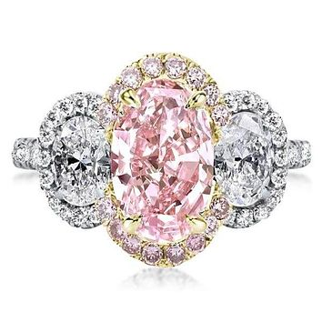 A Stunning 3CT Oval Cut Pink Sapphire Journey Halo Ring