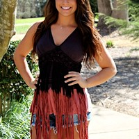 Halter top with fringe and crochet.