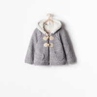 Fleece-lined hooded coat with toggles