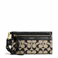 LEGACY LARGE WRISTLET IN PRINTED SIGNATURE FABRIC