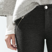 Trousers with zips and pockets