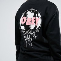 Obey Oversized Boyfriend Sweatshirt With World Back Graphic at asos.com