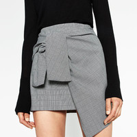 MINI SKIRT WITH A KNOT IN FRONTDETAILS