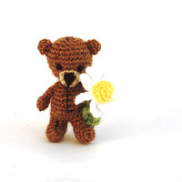 little teddy bear holding an ox-eye daisy flower, tiny tatted animal, bear figurine, miniature fabric, walking bear, animal figurine