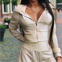 Hot style women's clothing is a hot seller with sparkly tops and trouser suits