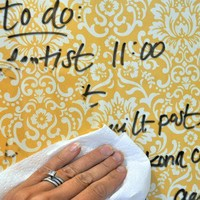 DIY dry erase board - frame with glass, scrap book paper, and a marker!