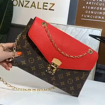 Free shipping: LV vintage simple clutch bag crossbody chain bag