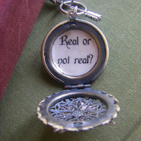 Hunger Games Real or Not Real Locket by CHAiNGEthesubject on Etsy