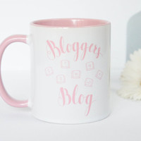 Coffee Mug for Bloggers 'Bloggers gonna Blog'. Handwritten design on pink and white mug. Gift to you or your blogging friend. Funny saying