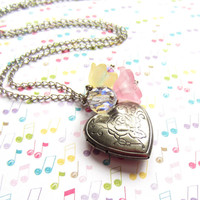 Small silver heart locket with pink and yellow flower accents