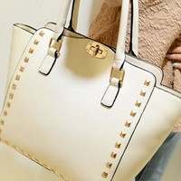 White handbag with rivets  from shoplayla