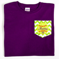 Short Sleeve Chevron Pocket T-shirt with Appliqued Softball, Name and Jersey Number. Perfect for Softball Moms or Grandmothers!