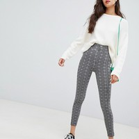 Bershka button top leggings in check at asos.com