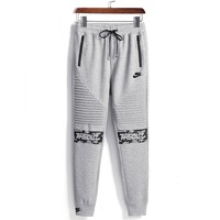 NIKE spring and autumn new letters embroidered trousers men's beam legs casual harem feet feet pants grey