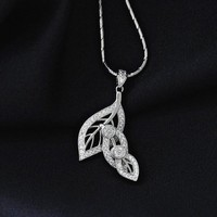 Magic Pieces Woman's Rhodium Plated Spinning Triple Tree Leaves Full White CZ Paved Pendant Necklace