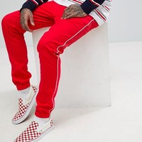 ASOS Skinny Joggers In Red With White Piping at asos.com