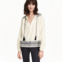H&M Embroidered Cotton Blouse $34.99