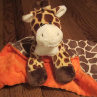 Cuddle Giraffe Security Blanket. With Orange Minky fabrics for extra softness.This cute little giraffe would love to be loved by your baby.