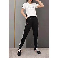 """""""FILA"""" Woman Leisure Fashion Letter Personality Printing Crew Neck Spell Color Short  Sleeve Tops Stripe Trousers Two-Piece Set Casual Wear Sportswear"""