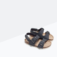 Sandal with buckles